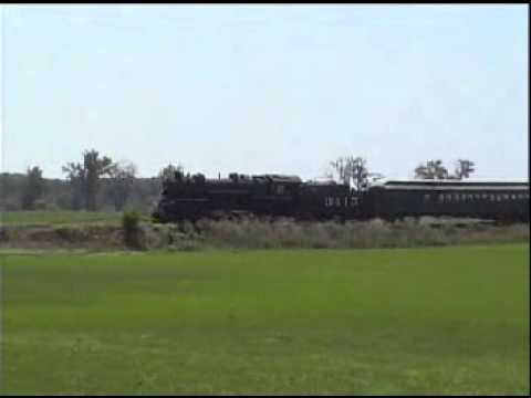 Abilene&Smokey Valley Rwy trainchase  ATSF3415 Pacific with tourist train moving along in the farm f