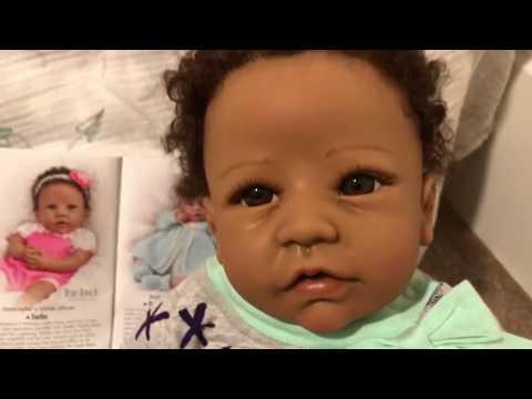 Browsing Ashton Drake's New Catalog With Silicone Baby Tasha :)