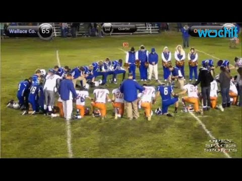 HIgh School Football Player Dies On Field After Scoring Touch Down
