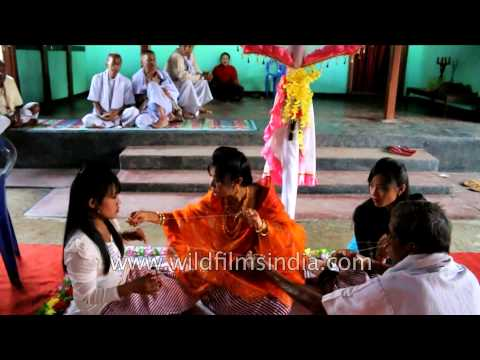 Bride makes a garland for her groom: Manipuri wedding