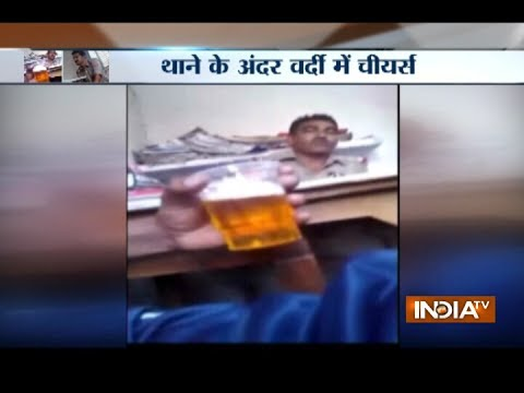 Viral Video: Policemen turn police station into beer bar in UP's Hathras