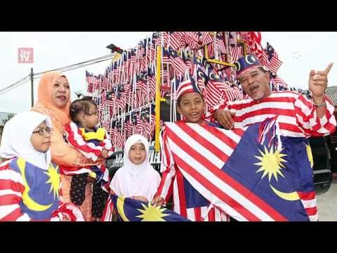 Tailor busy sewing outfits made from Jalur Gemilang