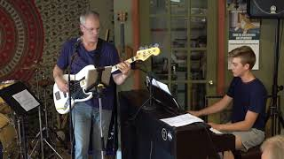 Sean, Zach and Odessa Performing Moving Out Main Street Music and Art Studio
