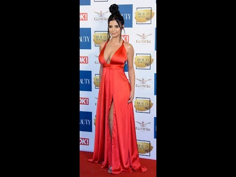 Demi Rose Mawby shows never-ending cleavage in plunging gown thumbnail