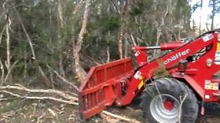 Front End Loader Schaffer 5050z Being Used As A Bulldozer With Stick Rake In Australia