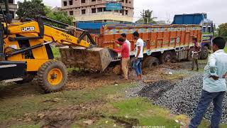 tata 3718 bs4 14 wheeler lorry stuck in mud rescue by jcb dozer