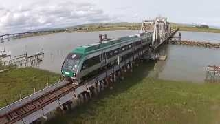 Aerial view Sonoma Marin SMART Train entering Marin County at Black Point Bridge