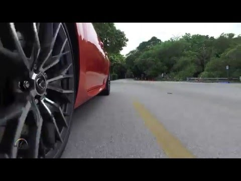 Why do car wheels spin backwards on video?