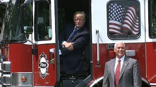 Trump rides a fire truck in celebration of US-made goods