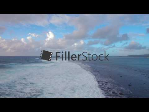 Seascape with foamy waves of blue Indian Ocean, aerial view