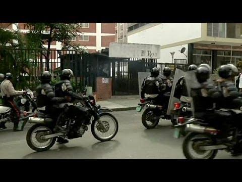 Clashes follow Venezuela police raids on protest camps