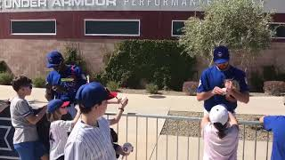 Cubs players signing autographs to young fans - Chicago Cubs 2019 Spring Training