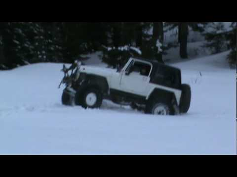 Jeep Driving In The Snow Avoiding Stuck Cars