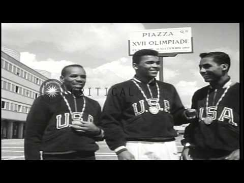 Edward Crook, Cassius Clay (later Muhammad Ali), and Wilbert McClure win gold med...HD Stock Footage