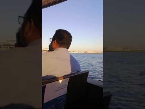 Riding a boat at Dubai Creek