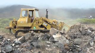 Caterpillar 977L Crawler Shovel moving volcanic rock on Tenerife