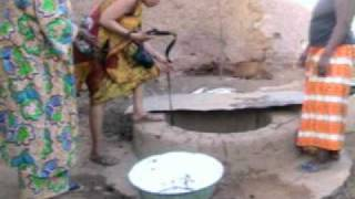 Drawing water from a well in Konni Niger
