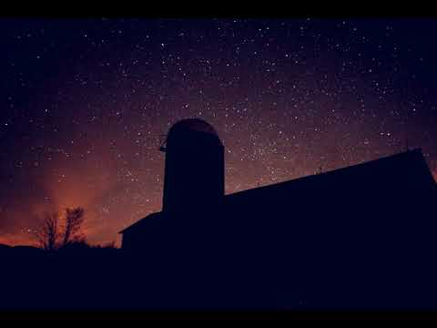 Star trails over the Manhattan Country School barn