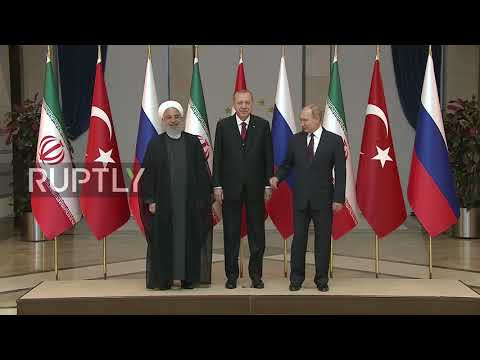 Turkey: Putin, Erdogan and Rouhani pose for photos ahead of trilateral talks