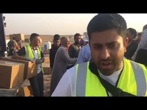 Distributing aid to refugees in Jordan 9km from the Syrian border