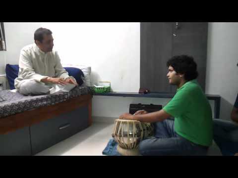 Pandit Divyang Vakil ( guruji ) teaching Tabla to senior students (Talavya artists)