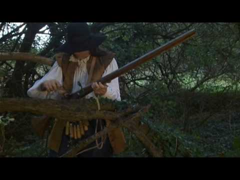 Loading and firing a matchlock musket - YouTube