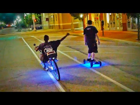 his electric skateboard is LIT