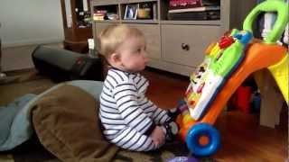 6 month old playing with toys