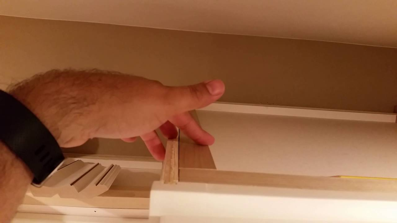 Diy installing large crown molding on rta kitchen cabinets for Attaching crown molding to kitchen cabinets