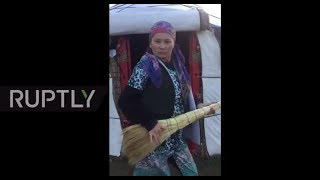 Kyrgyz woman breaks into dance to protest child marriage