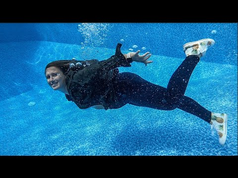 Swimming Underwater with Clothes on Jeans and Jacket