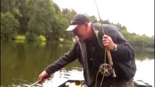 Fly fishing on a boat in Devon lakes Dadyal  fishing in Pakistan samon.   Great catch