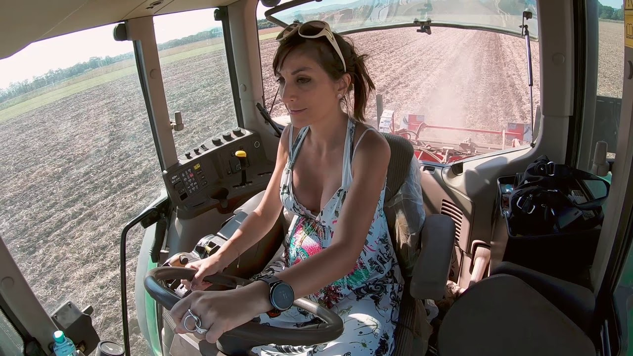 Farmer Girl Drives With The John Deere Deep Loosening To