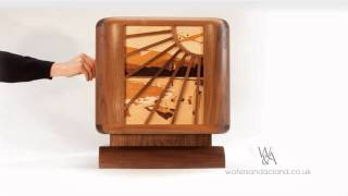 Cunard Cabinet This Art Deco inspired tambour door media cabinet was designed by Will and Holly Acland. The marquetry,
