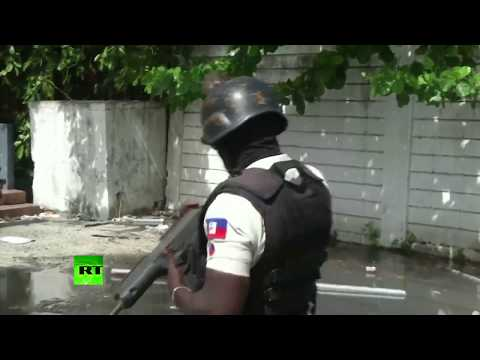 Looting & clashes: Haiti's capital in chaos as protests rage over rising fuel prices