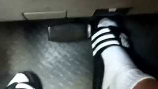 pedal pumping in socks and adidas sandals
