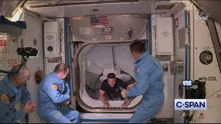 NASA Astronauts Bob Behnken and Doug Hurley enter the International Space Station