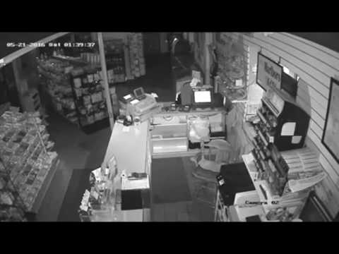 Surveillance footage of burglars stealing more than $900 in cigarettes from J's Corner Store in Bay