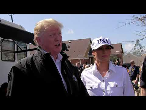 Trumps distribute bottled water at FEMA center