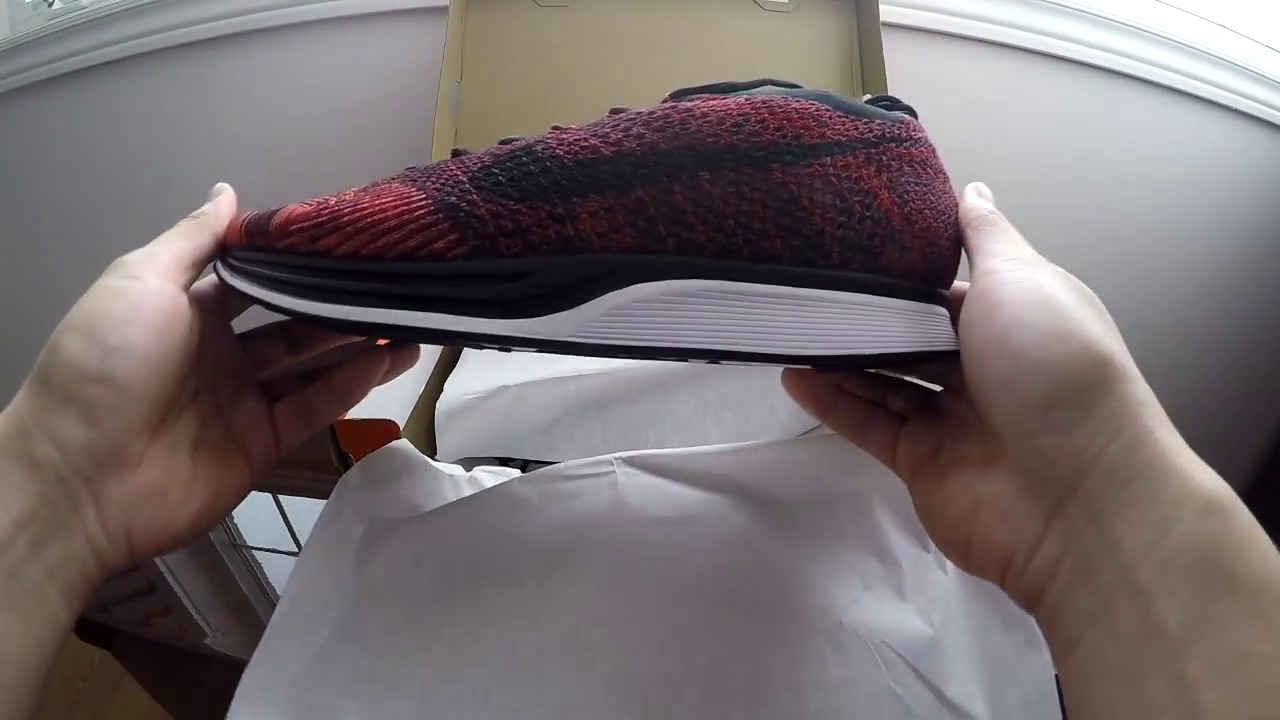 e07c6ccf6492 ... shop 30 second unboxing nike flyknit racer red rooster 47869 2ae6f ...
