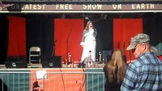 cassie pack singing brass in pocket at the pumpkin show.
