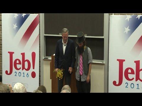 Jeb Bush prays with a peace activist in Iowa