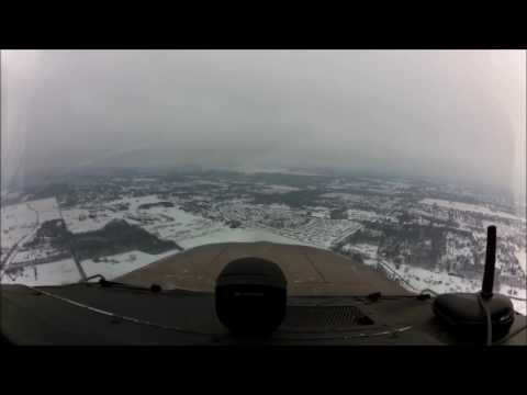 Landing at Akron/Canton Ohio  (KCAK).... ILS 23 Approach down thru clouds and light snow