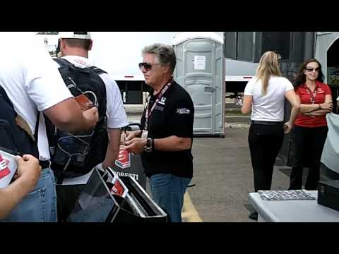 see the living legend, Mario Andretti, at work-signing autog