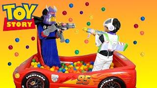 Surprise Toys GIANT Ball Pit Challenge Toy Story Buzz vs Zurg Disney Cars Ball Pit Surprise Toys