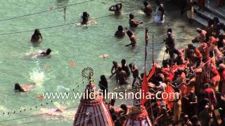 Devotees take sacred dip on the auspicious day of Kumbh Mela