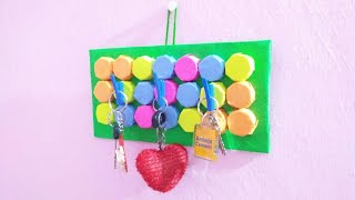 HOW TO MAKE KEY HOLDER OUT  WASTE BOTTLE CAPS AND PEN TOP. Simple and Easy steps