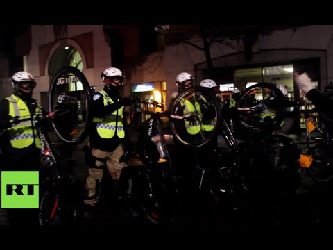 Canada police contain protest in Montreal with bicycles & flash lights