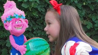 Yulya playing with Princess Snow White and Poppy troll
