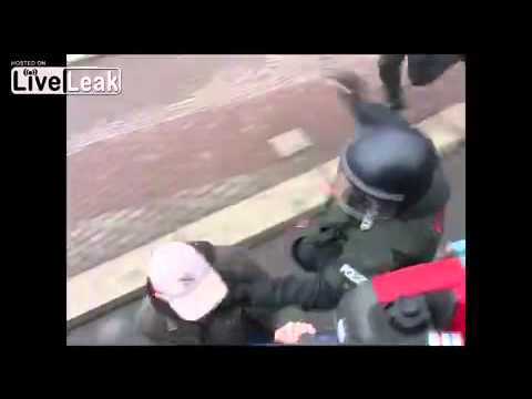 Police use excessive force in arresting an anti-Nazi protester in Dresden, Germany